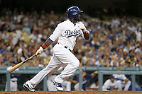 Los Angeles Dodgers outfielder Tony Gwynn,jr. #10 bats against the Colorado Rockies at Dodger Stadium on July 26, 2011 in Los Angeles,California. Los Angeles defeated Colorado 3-2.(Larry Goren/Four Seam Images)