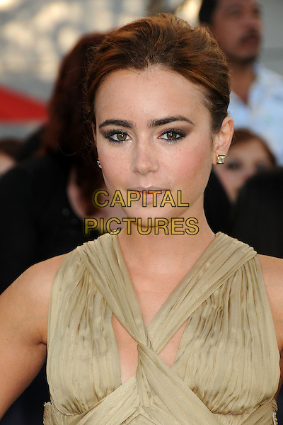 "LILY COLLINS .""The Twilight Saga: Eclipse"" Los Angeles Premiere at the 2010 Los Angeles Film Festival held at Nokia Theatre LA Live, Los Angeles, California, USA, 24th June 2010..portrait headshot gold beige dress hair up make-up studs earrings .CAP/ADM/BP.©Byron Purvis/AdMedia/Capital Pictures."