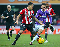 Bolton Wanderers' Antonee Robinson vies for possession with Brentford's Nico Yennaris<br /> <br /> Photographer Alex Dodd/CameraSport<br /> <br /> The EFL Sky Bet Championship - Brentford v Bolton Wanderers - Saturday 13th January 2018 - Griffin Park - Brentford<br /> <br /> World Copyright &copy; 2018 CameraSport. All rights reserved. 43 Linden Ave. Countesthorpe. Leicester. England. LE8 5PG - Tel: +44 (0) 116 277 4147 - admin@camerasport.com - www.camerasport.com