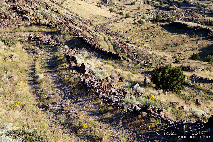 Dating to Spanish settlement in New Mexico and the Camino Real, the escarpment at La Bajada, which lies southwest of Santa Fe, posed a formidable challenge to the development of a transportation network along the Rio Grande Valley. In 1909 work started on the roadbed and cuts were made into the solid basalt caprock and retaining walls were built of dry masonry. The project was heralded as an engineering wonder along New Mexico's Scenic Highway that soon became a part of the National Old Trails Road Ocean-to-Ocean Highway. In 1924 the road was realigned along the upper slopes of the escarpment. With the creation of the federal highway system in 1926, this improved roadway became a part of the U.S. 66 and U.S. 85 alignment. The alignment remained a part of the highway system until 1931 when a new alignment was completed along a gentler slope three miles to the south.