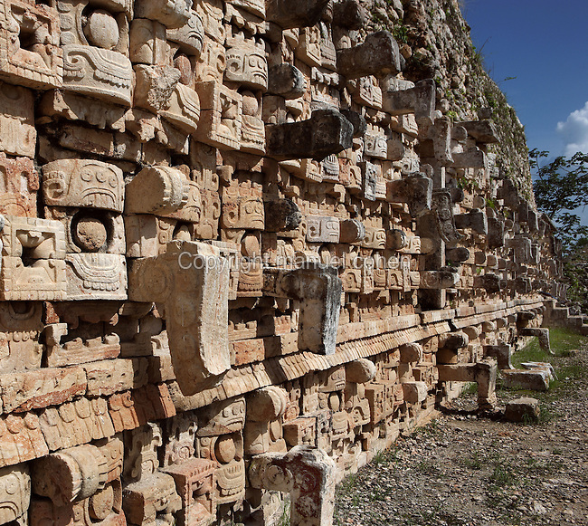 "Western façade of the Codz Poop (""Rolled-up matting"" in Maya), originally covered with 250 stone masks of Chaac, the big-nosed god of rain, Puuc Architecture, 700-900 AD, Kabah, Yucatan, Mexico. Picture by Manuel Cohen"