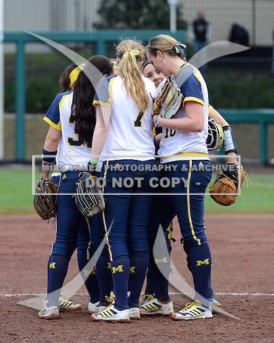 Michigan Wolverines team huddle during the season opener against the Florida Gators on February 8, 2014 at the USF Softball Stadium in Tampa, Florida.  Florida defeated Michigan 9-4 in extra innings.  (Copyright Mike Janes Photography)