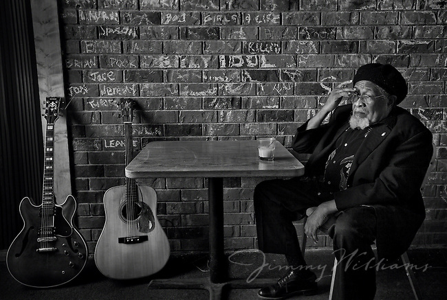 Blues guitarist Drink Small sits for a drink inside of Wally's Grill and Ale House, Columbia South Carolina.