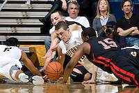 David Kravish of California fights for a loose ball during the game against Utah at Haas Pavilion in Berkeley, California on January 14th, 2012.  California defeated Utah, 81-45.