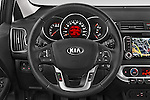 Car pictures of steering wheel view of a2015 KIA Rio World Edition 5 Door Hatchback Steering Wheel