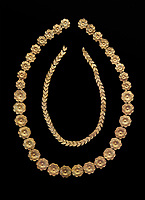 Mycenaean gold necklace from the Mycenaean cemetery of Midea tholos tomb , Dendra, Greece. National Archaeological Museum Athens. Black Background<br /> <br /> Inside mycenaean necklace has gold ivy leaf beads, Cat No 7354. The outer mycenaean necklace has rosette shaped gold beads, Cat No 7342. 15th-14th century BC.