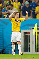 James Rodriguez of Columbia celebrates scoring a goal after making it 1-0