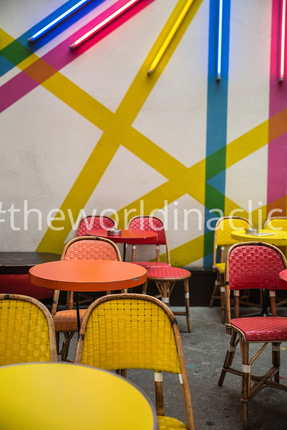 FRANCE, Paris, Empty chairs and tables in a Parisian Cafe