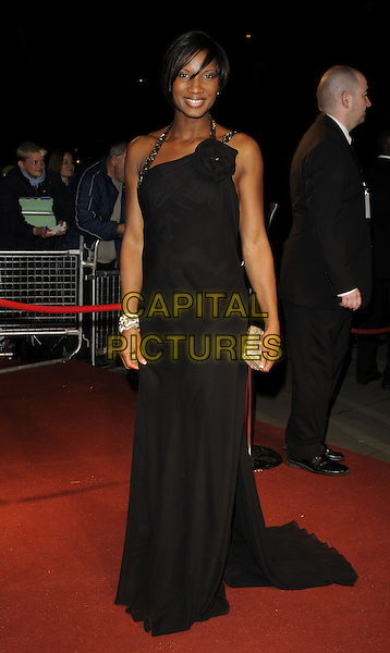 DENISE LEWIS.The British Academy Television Awards 2008 after party held at the Grosvenor House Hotel, London, England..April 20th 2008. .BAFTA BAFTA's full length black dress gold clutch bag purse corsage .CAP/CAN.©Can Nguyen/Capital Pictures.