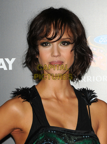 JESSICA ALBA.L.A. Premiere of Valentine's Day held at The Grauman's Chinese Theatre in Hollywood, California, USA. .February 8th, 2010.headshot portrait eyeshadow black green feathers .CAP/RKE/DVS.©DVS/RockinExposures/Capital Pictures.