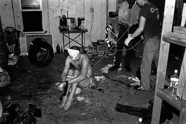 """Summer 2002, New York, NY.. The client, a graphic designer, was subjected to physical abuse that ranged from burning with cigarettes to force feeding and running in place for several hours.. In the summer of 2002, New York based artist, Brock Enright and a group of his friends from Virginia, started a kidnapping service called Videogames Adventure Services. The clients would hire them to provide a reality based kidnapping experience, while still retaining the ability to stop the """"game"""" at anytime. Parameters were set ahead of the service, detailing the activities to be performed, but the actual time of the kidnapping was kept secret to add to the fantasy. An abuse fetish seemed to be shared by the clients as the activites were more physical than sexual in nature. Prices started at $2500 and the imagination of the client and actors were the only limits."""