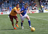 Jack Hamilton getting the better of Jake Carroll in the SPFL Betfred League Cup group match between Queen of the South and Motherwell at Palmerston Park, Dumfries on 13.7.19.