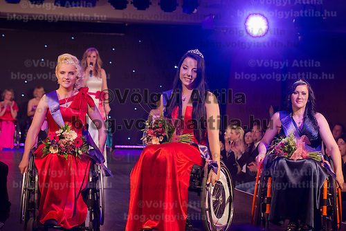 Winner Fanni Illes (C) of Hungary with runner-ups Hadarag Paula Andrea (R) of Romania and Eminna Mirna Fejzovich (L) of Bosnia and Herzegovina celebrate their victory during the Miss Colours International wheelchair beauty contest in Budapest, Hungary on March 22, 2014. ATTILA VOLGYI