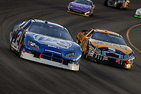 Apr 22, 2006; Phoenix, AZ, USA; Nascar Nextel Cup driver Kurt Busch of the (2) Miller Lite Dodge Charger battles Matt Kenseth for position during the Subway Fresh 500 at Phoenix International Raceway. Mandatory Credit: Mark J. Rebilas-US PRESSWIRE Copyright © 2006 Mark J. Rebilas..
