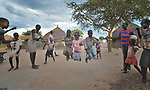 Dinka children jump rope in the Rhino Refugee Camp in northern Uganda. As of April 2017, the camp held almost 87,000 refugees from South Sudan, and more people were arriving daily. About 1.8 million people have fled South Sudan since civil war broke out there at the end of 2013. About 900,000 have sought refuge in Uganda.