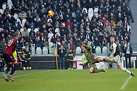 6th January 2020; Allianz Stadium, Turin, Italy; Serie A Football, Juventus versus Cagliari; Luca Pellegrini of Cagliari clears the danger with a header from Cristiano Ronaldo of Juventus - Editorial Use