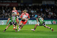 Richard Hibbard of Gloucester Rugby is tackled by Sam Hill and Jack Nowell of Exeter Chiefs during the European Rugby Challenge Cup semi final match between Gloucester Rugby and Exeter Chiefs at Kingsholm Stadium on Saturday 18th April 2015 (Photo by Rob Munro)