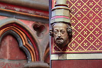 Sculpted head of Viollet le Duc, 1814-79, architect, as a cornice, sculpted 1859 in 13th century style, in the axial Chapelle de la Vierge or Lady Chapel, behind the tabernacle, in the Basilique Cathedrale Notre-Dame d'Amiens or Cathedral Basilica of Our Lady of Amiens, built 1220-70 in Gothic style, Amiens, Picardy, France. Amiens Cathedral was listed as a UNESCO World Heritage Site in 1981. Picture by Manuel Cohen