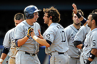 22 May 2010:  FIU's Rudy Flores (11, left) celebrates his sixth inning three-run home run with Garrett Wittels (10) as the Florida Atlantic University Owls defeated the FIU Golden Panthers, 14-10, at FAU Stadium in Boca Raton, Florida.