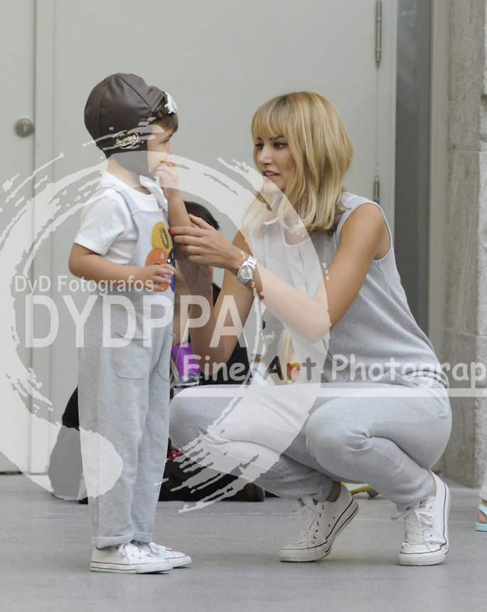 Fashion designer and model Alba Carrillo before show with her son ( Former moto Gp rider Fonsi Nieto´s son)