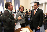 Former state archivist Guy Rocha, left, talks with Assemblywoman Marilyn Dondero Loop, D-Las Vegas, and Gov. Brian Sandoval before the Assembly floor session held in the historic Assembly chamber at the Capitol in Carson City, Nev. on Thursday, March 10, 2011..Photo by Cathleen Allison