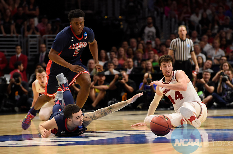 28 MAR 2015:  Gabe York (1) of the University of Arizona and Frank Kaminsky (44) of the University of Wisconsin race after a loose ball during the 2015 NCAA Men's Basketball Tournament held at the Staples Center in Los Angeles, CA.  Wisconsin defeated Arizona 85-78 to advance to the Final Four.  Jamie Schwaberow/NCAA Photos