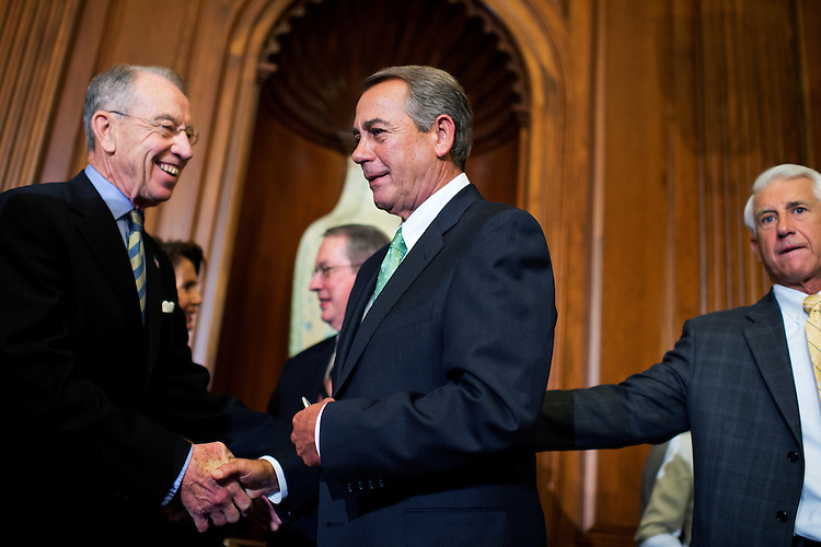 UNITED STATES - MAY 21: Speaker John Boehner, R-Ohio, center, talks with Sen. Charles Grassley, R-Iowa, during a bill signing ceremony in the Capitol's Rayburn Room for the Justice for Victims of Trafficking Act, May 21, 2015. Rep. Dave Reichert, R-Wash., appears at right. (Photo By Tom Williams/CQ Roll Call)
