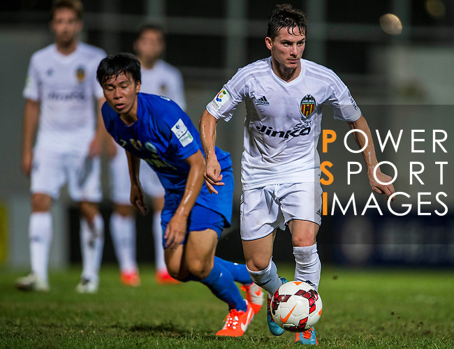 (R) Pablo Piatti of Valencia CF competes for the ball with (L) Cheuk Fung Chow of BC Rangers F during LFP World Challenge 2014 between Valencia CF vs BC Rangers FC on May 28, 2014 at the Mongkok Stadium in Hong Kong, China. Photo by Victor Fraile / Power Sport Images