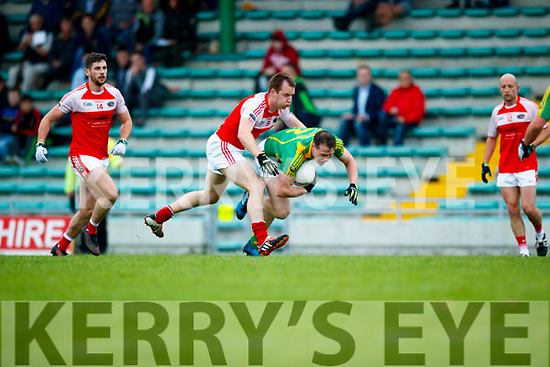 Mark Griffin South Kerry in action against Dara O'Sullivan Dingle in the Quarter Final of the Kerry Senior County Championship at Austin Stack Park on Sunday.