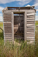 Old outhouse behind an abandoned school in Boyes, MT