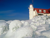 Benzie County, MI:  Point Betsie Lighthouse above the ice mounded shoreline on Lake Michigan