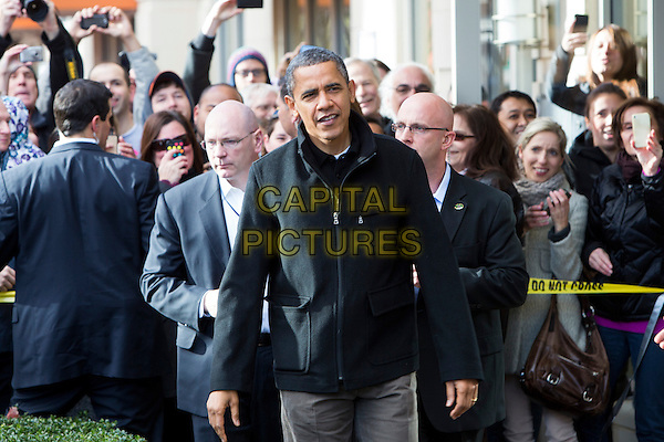 United States President Barack Obama, center, and daughters Sasha, left, and Malia, right, shop in Arlington, Virginia on Small Business Saturday, .November 24th, 2012 .half length black jacket fans crowd .CAP/ADM/CNP/KT.©Kristoffer Tripplaar/CNP/AdMedia/Capital Pictures.