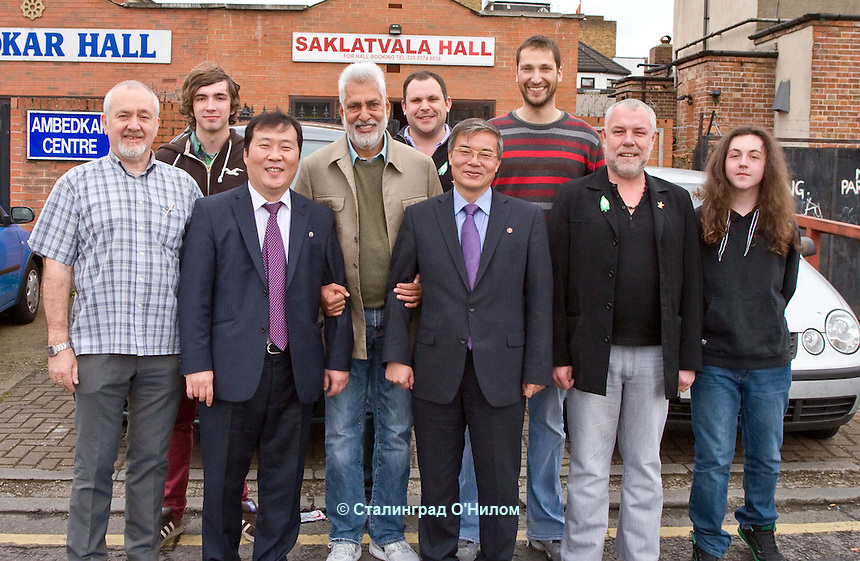 Ambassador to UK His Excellency Mr. Hyon Hak Bong and Embassy official Mr Myongsin Mun of the Democratic People's Republic of Korea posing with comrades after attending a Saklatvala Hall CPGBML Commemoration which celebrated the centenary of  Kim Il-sung's birth, Southall, Easter Sunday 2012