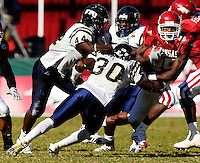 Florida International University Golden Panthers versus the University of Arkansas Razorbacks at Donald W. Reynolds Razorback Stadium, Fayetteville, Arkansas on Saturday, October 27, 2007.  The Razorbacks defeated the Golden Panthers, 58-10...Arkansas tailback Felix Jones (25) attempts to squeeze past FIU senior defensive back Cory Fleming (30) (Orlando, Fla.) in the third quarter.