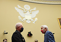 Admiral Brett Giroir, United States Assistant Secretary for Health, talks to Dr. Anthony Fauci, director of the National Institute for Allergy and Infectious Diseases, before testifying at a House Subcommittee on the Coronavirus Crisis hearing on a national plan to contain the COVID-19 pandemic, on Capitol Hill in Washington, DC on Friday, July 31, 2020.  <br /> Credit: Kevin Dietsch / Pool via CNP /MediaPunch