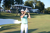 Gainesville, VA - August 2, 2015: Tournament Champion Troy Merritt holds the Quicken Loans Trophy after winning the 2015 Quicken Loans Nationals at the Robert Trent Jones Golf Club in Gainesville, VA. August 2, 2015.  (Photo by Philip Peters/Media Images International)