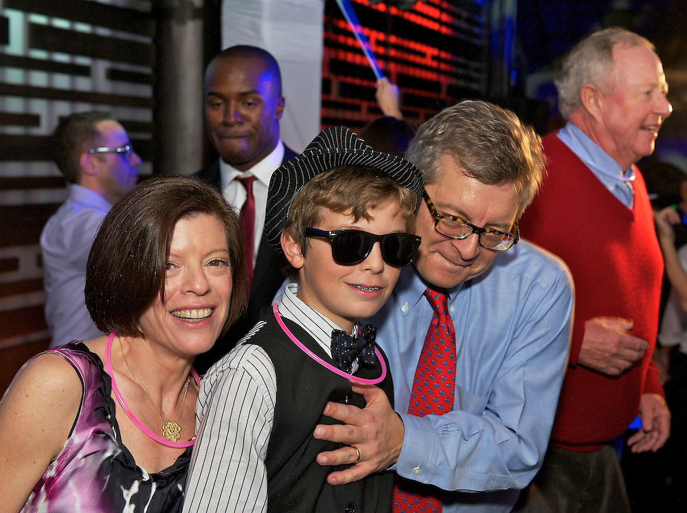 Bar Mitzvah boy with mom and dad