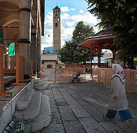 Gazi Husrev-beg Mosque, built 1530-32, and behind, the Clock Tower which keeps lunar time according to the sun and moon, helping the locals to time their call to prayer, built in the 17th century, Sarajevo, Bosnia and Herzegovina. The mosque complex includes a maktab and madrasa (Islamic primary and secondary schools), a bezistan (vaulted marketplace)and a hammam. The mosque was renovated after damage during the 1992 Siege of Sarajevo during the Yugoslav War. Picture by Manuel Cohen