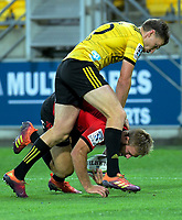 Beauden Barrett collides with tryscorer George Bridge during the Super Rugby match between the Hurricanes and Crusaders at Westpac Stadium in Wellington, New Zealand on Friday, 29 March 2019. Photo: Dave Lintott / lintottphoto.co.nz