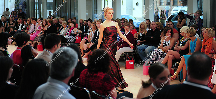 A model walks the runway at Wisconsin Fashion Week at the Overture Center