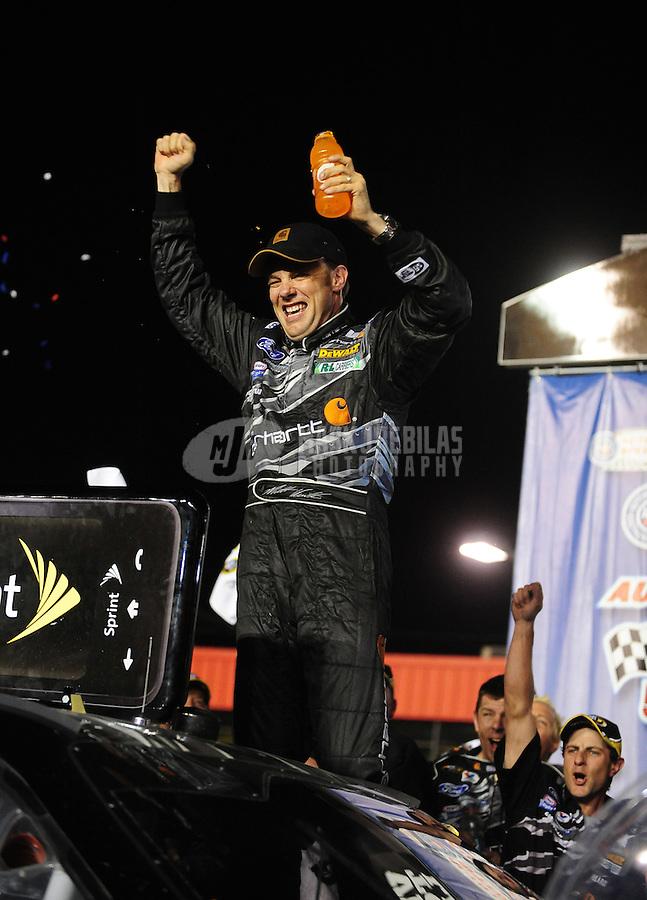 Feb 22, 2009; Fontana, CA, USA; NASCAR Sprint Cup Series driver Matt Kenseth celebrates after winning the Auto Club 500 at Auto Club Speedway. Mandatory Credit: Mark J. Rebilas-