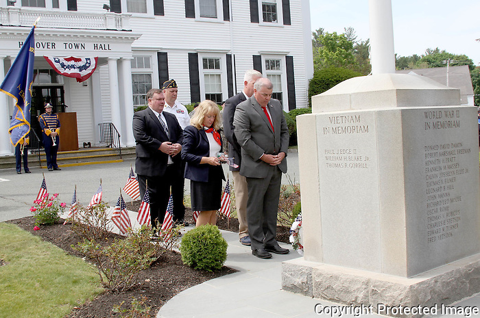 American Legion Commander Ray Miller and Hanover Selectmen   bow their heads at a memorial during the Hanover Memorial Day parade on Monday, May 25, 2015.(Photo by Gary Wilcox)
