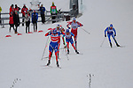 HOLMENKOLLEN, OSLO, NORWAY - March 16: Sprint on the home stretch. Alexander Legkov of Russia (RUS) leading during the Men 50 km mass start, free technique, at the FIS Cross Country World Cup on March 16, 2013 in Oslo, Norway. (Photo by Dirk Markgraf)