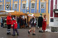 Children play in the street during Mozart Week in a village near Salzburg, Austria February 28 2006.  Alan Greth)