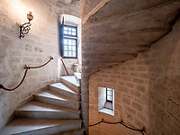 BNPS.co.uk (01202 558833)<br /> Pic: LeggettPrestige/BNPS<br /> <br /> PICTURED: The Chateau's stone spiral staircase.<br /> <br /> A majestic medieval chateau with its own fortifications and coat of arms has emerged on the market for £3.3million. (3.9m euros)<br /> <br /> Nestled in green countryside in south west France, Chateau de Vouzan comes with 23 hectares of land which can be looked out upon from its turreted watchtowers.<br /> <br /> It is approached by a sweeping drive through a large gate showing the coat of arms with three horses in fighting pose.<br /> <br /> The 15th century chateau, in Angouleme, Charente, which is being sold by estate agent Leggett Prestige, has been granted 'protected historic monument' status by the French government.<br /> <br /> It has its own pigeon hut (dovecote), with various outbuildings including a caretaker's cottage and a large cottage with a barn attached. There is also a 12th century chapel in the grounds.