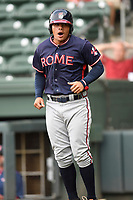 Left fielder Anthony Concepcion (23) of the Rome Braves reacts after scoring a run in game one of a doubleheader against the Greenville Drive on Tuesday, May 30, 2017, at Fluor Field at the West End in Greenville, South Carolina. Rome won, 10-7. (Tom Priddy/Four Seam Images)