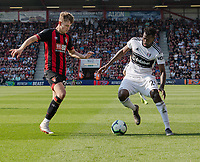 Bournemouth's David Brooks (left)  vies for possession with Fulham's Andre-Frank Zambo Anguissa (right) <br /> <br /> Photographer David Horton/CameraSport<br /> <br /> The Premier League - Bournemouth v Fulham - Saturday 20th April 2019 - Vitality Stadium - Bournemouth<br /> <br /> World Copyright © 2019 CameraSport. All rights reserved. 43 Linden Ave. Countesthorpe. Leicester. England. LE8 5PG - Tel: +44 (0) 116 277 4147 - admin@camerasport.com - www.camerasport.com