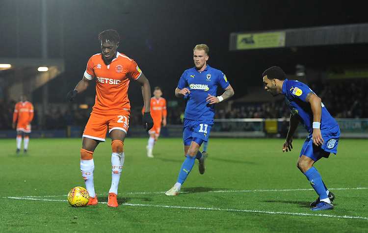 Blackpool's Armand Gnanduillet under pressure from AFC Wimbledon's Mitch Pinnock (left) and Andy Barcham<br /> <br /> Photographer Kevin Barnes/CameraSport<br /> <br /> The EFL Sky Bet League One - AFC Wimbledon v Blackpool - Saturday 29th December 2018 - Kingsmeadow Stadium - London<br /> <br /> World Copyright © 2018 CameraSport. All rights reserved. 43 Linden Ave. Countesthorpe. Leicester. England. LE8 5PG - Tel: +44 (0) 116 277 4147 - admin@camerasport.com - www.camerasport.com
