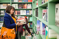 Hay on Wye, UK. Wednesday 01 June 2016<br /> Pictured:  A woman browses in the bool shop at Hay on Wye<br /> Re: The 2016 Hay festival take place at Hay on Wye, Powys, Wales
