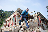 A man comes out from his destroyed house near at Kathmandu, Nepal. May 1, 2015